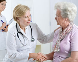 Female doctor consulting with female patient.
