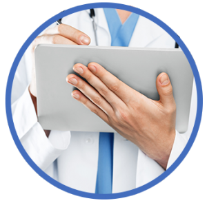 Physician writing on tablet.