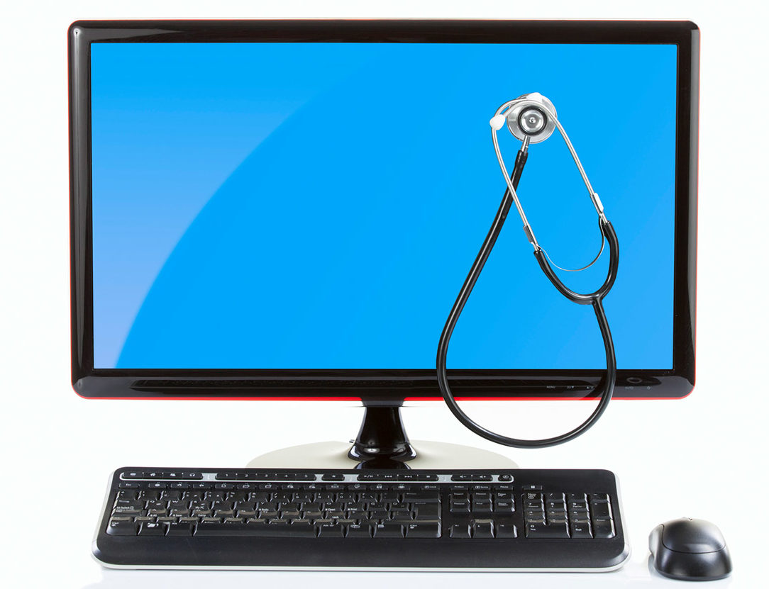 A stethoscope on a computer monitor depicting the automation of healthcare workflows.
