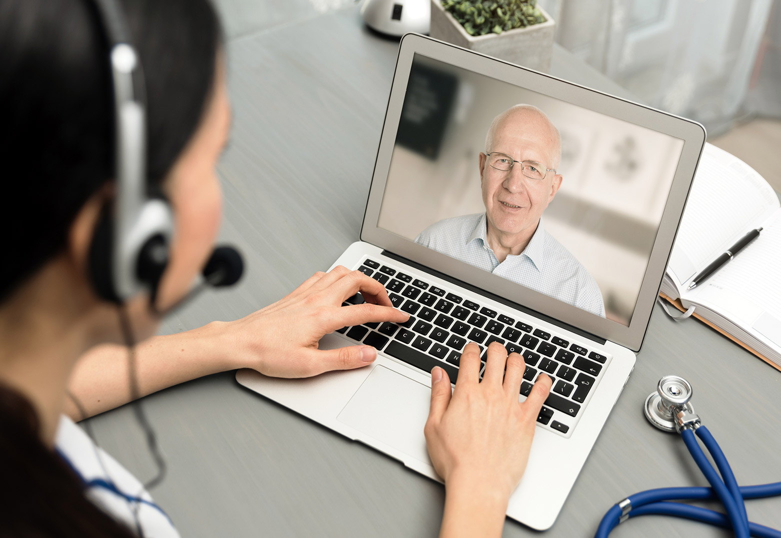 Doctor talking with a senior patient about his Annual Wellness Visit