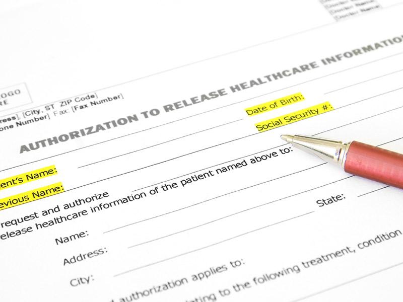 Health information release form with a pen on top.